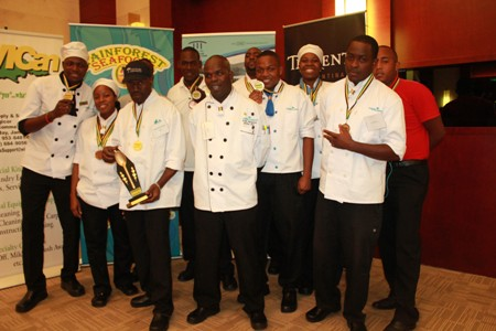 Some members of the Couples Resorts Team with their medals  Couples Sans Souci and Couples Tower Isle