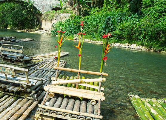 several handmade rafts made of bamboo in the water