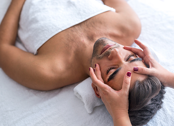 man getting a head massage at the spa