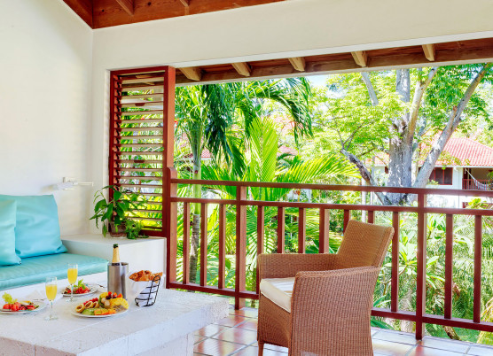 veranda with chairs, couch and garden views