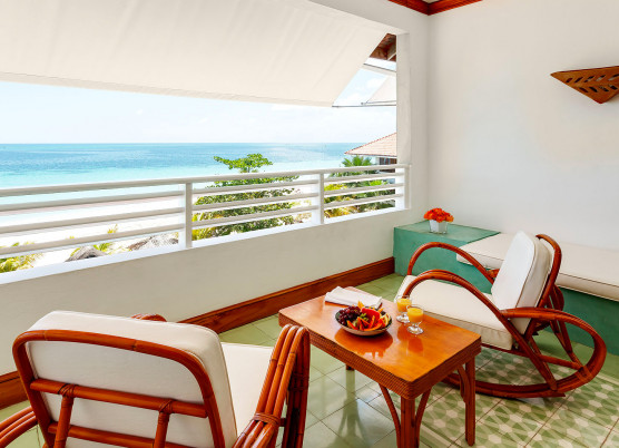 a patio with views of the beach