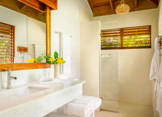 a suite bathroom with white marble and a walk in shower