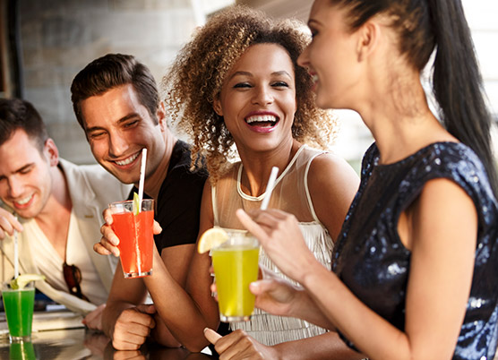 people laughing and having drinks