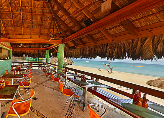 cabana grill bar during the day next to the beach
