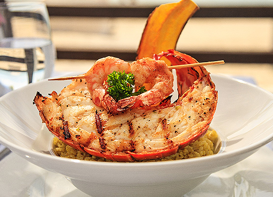 lobster in a bowl full of rice