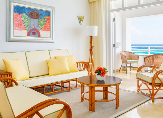 bamboo living room furniture with a view onto the balcony overlooking the ocean