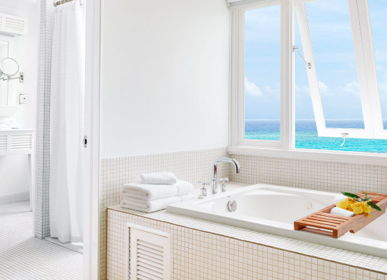 bathroom with white decorations and a window open overlooking the ocean