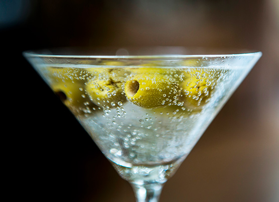martini with green olives