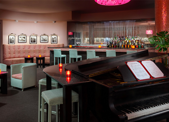 piano with an attached bar with small candles at a piano bar