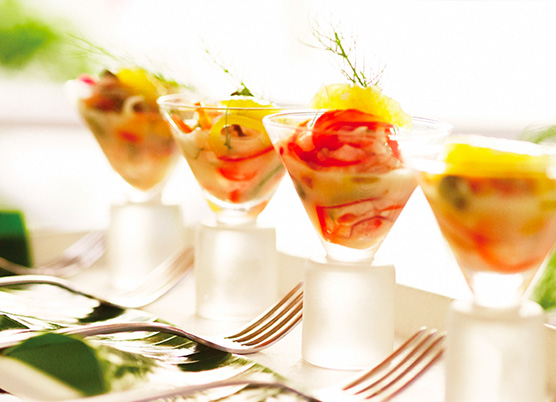 small martini cups with fish appetizer on a tray